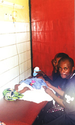Infant recieving malaria drugs intravenously