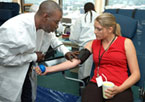 An image of a woman giving blood.