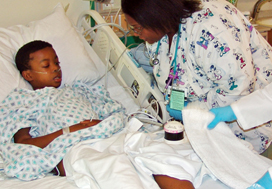 Mohammad Adisa in the Pediatric Intensive Care Unit, being treated for severe malaria. (Courtesy John Easton, University of Chicago Hospitals)