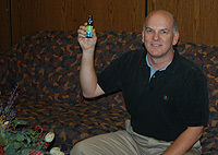 Tom Miller showing the homeopathic product that failed to protect him from malaria.(Courtesy Tom Miller.)