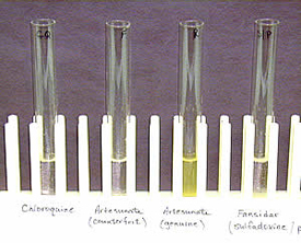 Colorimetric test for artesunate. From left to right: chloroquine, counterfeit artesunate, genuine artesunate, sulfadoxine-pyrimethamine. The genuine artesunate is distinguished by a positive yellow appearance.