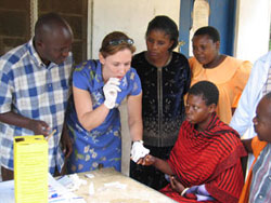 Dr. Bakari Amuri, Ifakara Health Institute, and Dr. Meredith McMorrow, CDC, train health workers at Bungu Dispensary, in Rufiji District, Tanzania, to take blood samples. Credit: S. Patrick Kachur, CDC