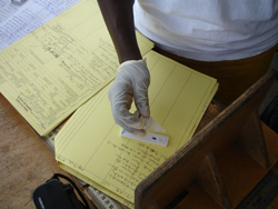 In Liberia, a worker uses an RDT to test a blood sample for malaria. Credit: Bob Wirtz, CDC