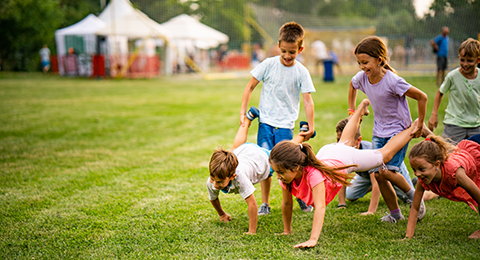 Children playing and racing in a campground