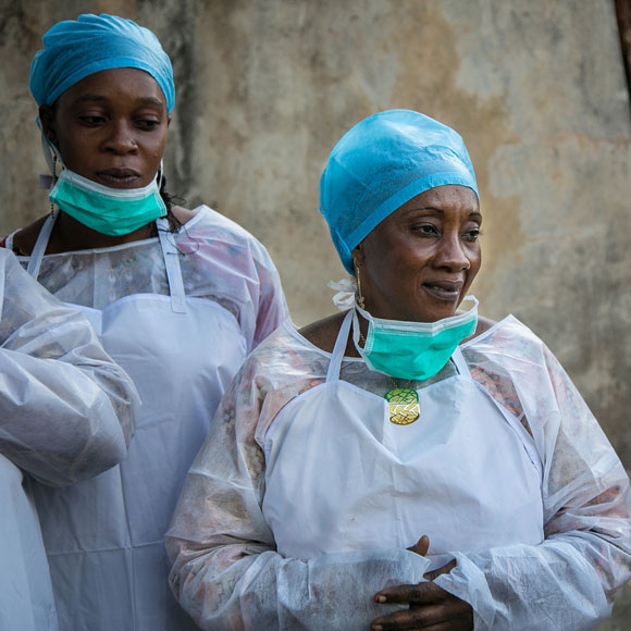 Public health workers wearing personal protective equipment