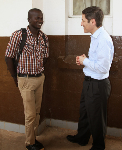 Dr. Tom Frieden speaks with Yusif Koroma, an Ebola survivor who is now taking of orphans at a nearby social services center.