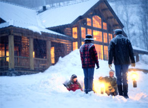Family in front of a house covered in snow