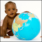 A baby plays with a ball in the style of a globe