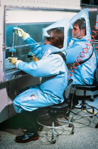 CDC laboratorians working in a BSL-4 Lab