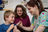Pre-teen boy receives vaccination