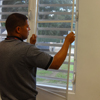 Man installs indoor window screens