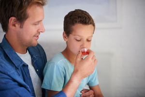 Photo of Dad and Son with Dosing Cup