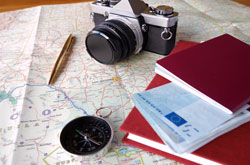 Images of map, camera, passport.