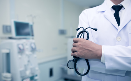 The figure shows a Medical Doctor in a doctor's coat holding a stethoscope.