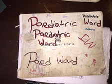 The figure above is a photograph showing a homemade sign for a pediatric ward in Sierra Leone.