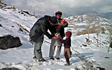 The figure above is a photograph showing a staff member of the polio eradication program administering polio vaccine to a child in Pakistan.
