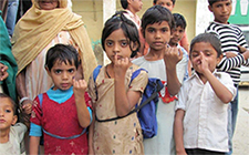 The figure shows children displaying their fingers with markings that show they have received the polio vaccine.