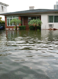 flood waters surrounding a home