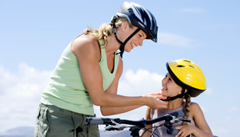 Photo: Mother and daughter wearing bicycle helmets
