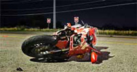 Photo: crashed red motorcycle