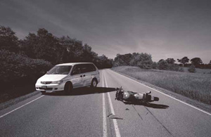 Photo: crashed motorcycle and a dented minivan