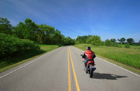 Photo: Man riding on motorcycle