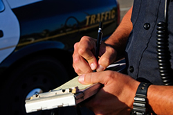 Policeman writing a traffic ticket