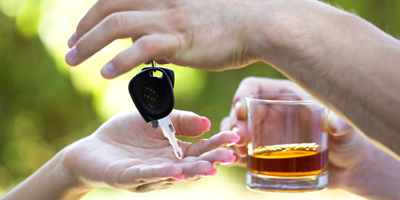 photo: someone with a drink handing over the car keys