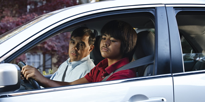 photo: teen son and father in a car