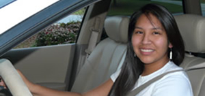 Photo: Teenage girl behind the wheel