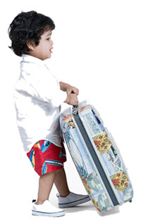 boy carrying a suitcase