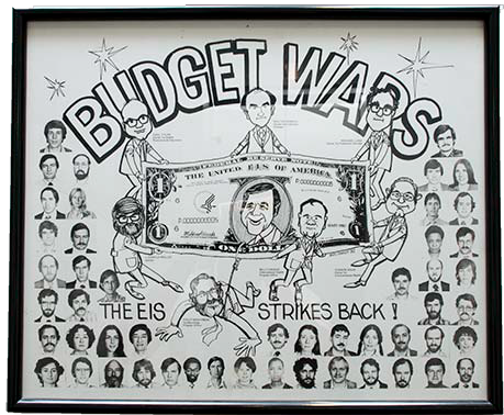 "The poster may not have been a class decision (or perhaps we all said, ""Yeah, sure, fine"" to someone's suggestion), but I don't know who brought the idea to Ed Biel and asked him to sketch it with our caricatures."