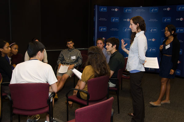 CDC subject matter experts prepare campers to represent the agency in a press conference.