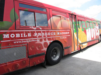 A colorful bus painted with an advertisement for