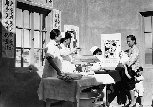 "San Francisco History Center, San Francisco Public Library  -  A doctor coaxing a child with his mother at a Chinatown Well Baby Clinic, San Francisco, 1934  -  In 1921, Congress passed the Maternity and Infancy Act to provide instruction in maternity and infant care. Through this funding, ""Well Baby Clinics"" were held across the country, typically segregated by ethnicity or race."