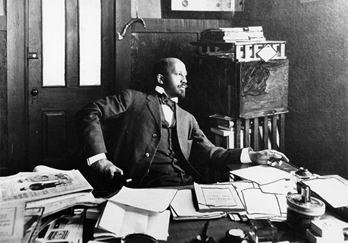 University of Massachusetts Amherst Libraries  -  Visionary sociologist and civil rights activist W.E.B. Du Bois (1868-1963) in his Atlanta University office, 1909  -  DuBois was among the first to note that the health disparities of American blacks stemmed from social conditions and not from inherent racial traits. He provided empirical evidence that linked the legacy of slavery and the inherent racism of American society to the poor health of blacks.