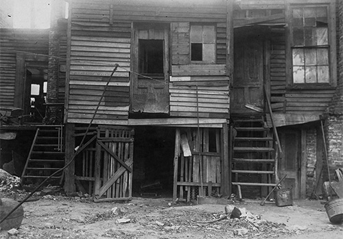 Atlanta History Center  -  An example of sub-standard African American housing in Atlanta, GA, 1920  -  The 13th Annual Conference for the Study of Negro Problems, held at Atlanta University in 1908, includes an indictment of alley housing characterized by over-crowding, and poor construction and sanitation.