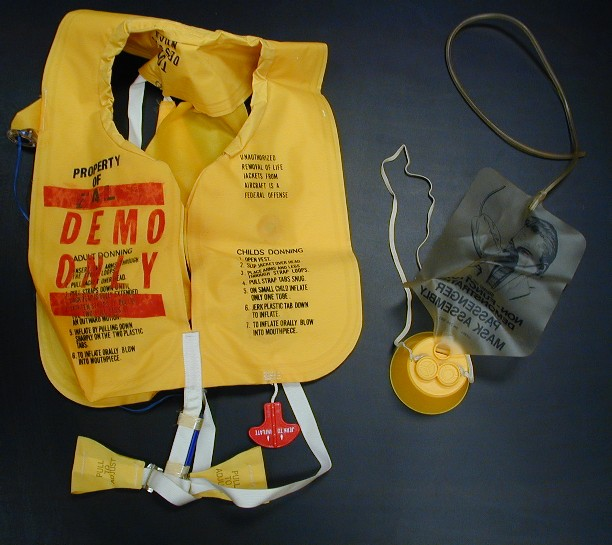 "This bright yellow life vest and oxygen mask are souvenirs from the ""Red Spots"" Epi-Aid. Donated by Kathy Rauch, 1995, 1995.136.1, CDCM Collection"