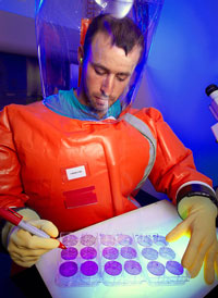 CDC scientist, Zach Braden, in BSL4 suit, 2013
