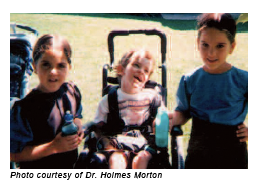 Photo of three children diagnosed with glutaric aciduria type I