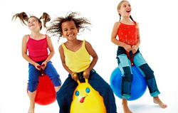 children bouncing on balls