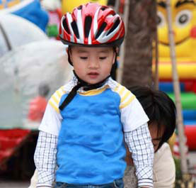 A young boy in a bike helmet