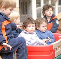 A group of kids playing in a wagon