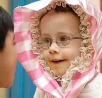 A smiling little girl with glasses