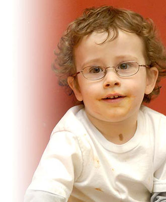 A boy wearing glasses