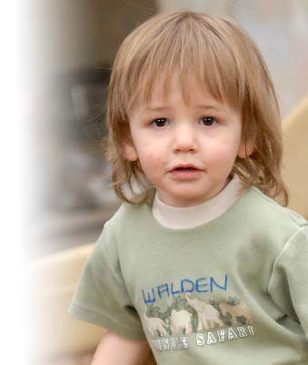 A toddler boy in a t-shirt