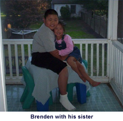 Brenden with his sister