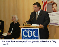 Andrew Baumann speaks to guests at Mother's Day event.