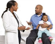 Parent talking with physician