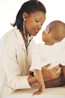healthcare provider checking child